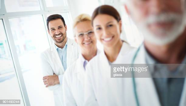 multi aged team of doctors. - sports team event stock photos and pictures