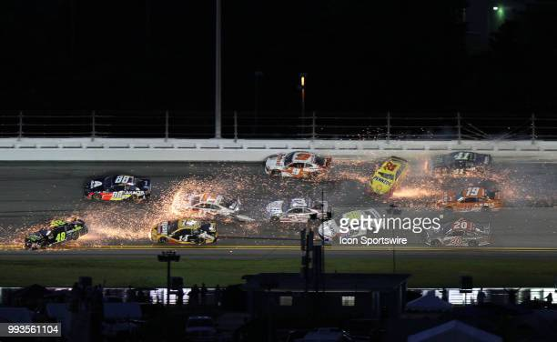 A multi car wreck involving many cars happens in turn 3 during the NASCAR Monster Energy Cup Series Coke Zero 400 on July 07 2018 at Daytona...