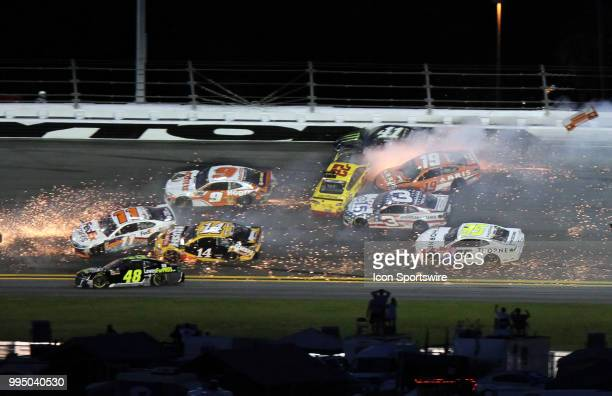 A multi car wreck involving many cars happens in turn 3 during the NASCAR Monster Energy Cup Series Coke Zero 400 in July 07 2018 at Daytona...