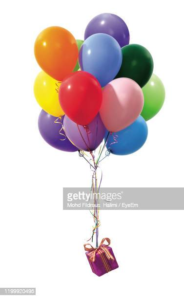 multi colored balloons against white background - 風船 ストックフォトと画像