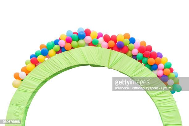 multi colored balloons on arch against clear sky - arch stock pictures, royalty-free photos & images