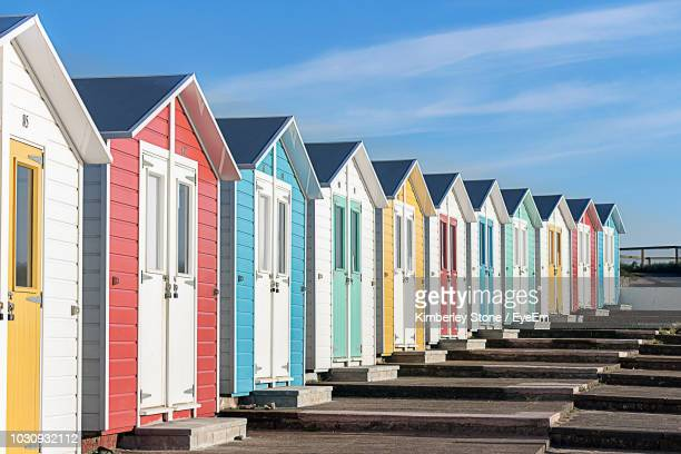 multi colored beach huts against sky - beach house stock pictures, royalty-free photos & images