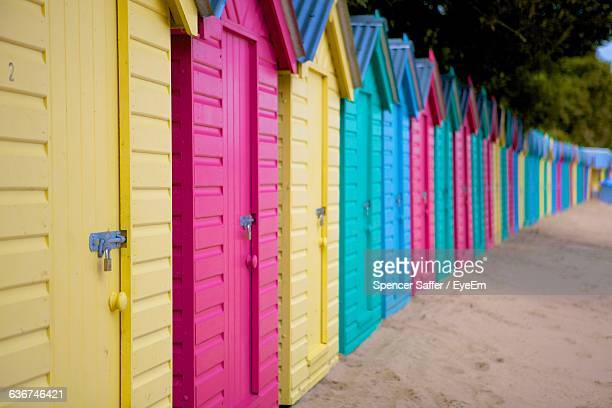 Multi Colored Beach Huts On Sand
