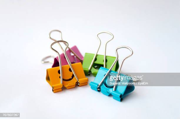 Multi Colored Binder Clips Against White Background