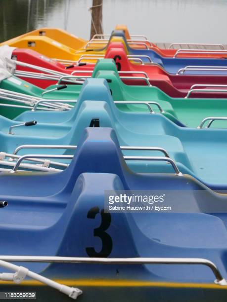 multi colored boats moored in lake - sabine hauswirth stock pictures, royalty-free photos & images