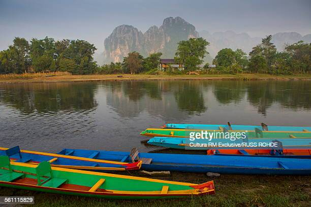 Multi colored boats moored on Nam Song River, Vang Vieng, Laos