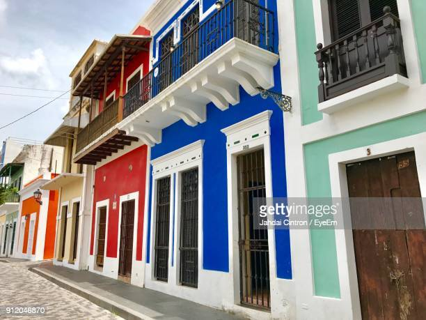 multi colored buildings against sky - san juan stock pictures, royalty-free photos & images