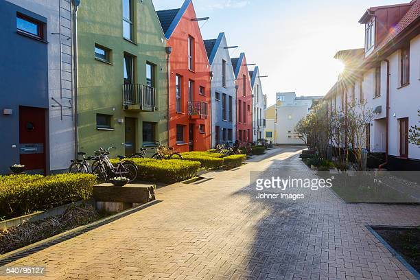 Multi colored buildings along footpath