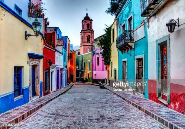 Multi colored buildings on street, Guanajuato, Central Mexico, Mexico,