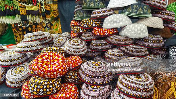 multi colored caps for sale - turkmenistan stock pictures, royalty-free photos & images