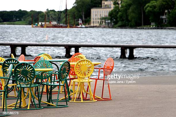 multi colored chairs and table on port by river in city - madison wisconsin stock pictures, royalty-free photos & images