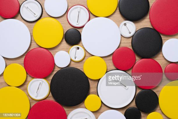 multi colored circle badges - brooch stock pictures, royalty-free photos & images