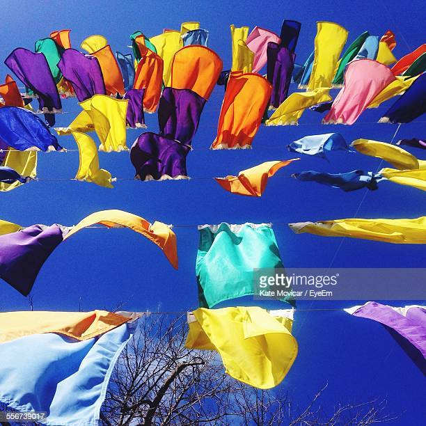 Multi Colored Clothes Hanging On Clothesline