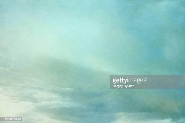 multi colored cloudy sky - wasserfarbe auf papier stock-fotos und bilder