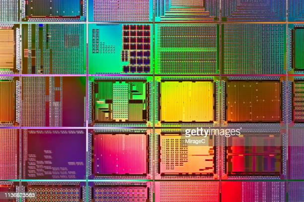 multi colored computer wafer macrophotography - conductor stock pictures, royalty-free photos & images