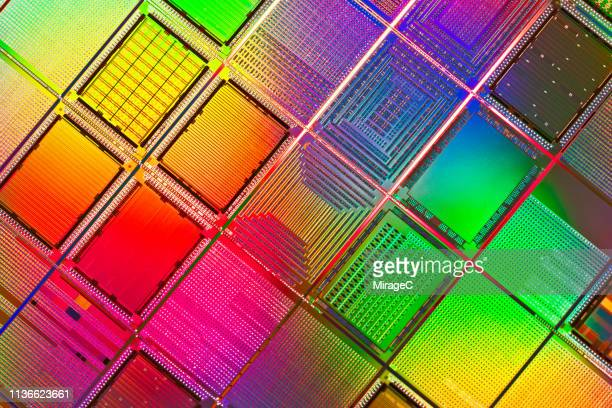 multi colored computer wafer macrophotography - cpu stock pictures, royalty-free photos & images