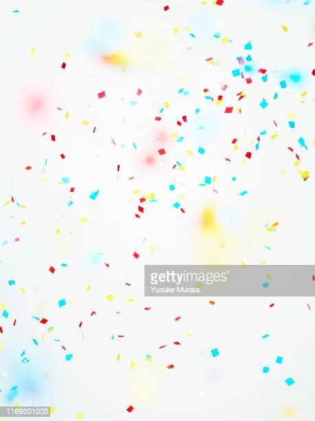 multi colored confetti against white background - focus on background stock pictures, royalty-free photos & images
