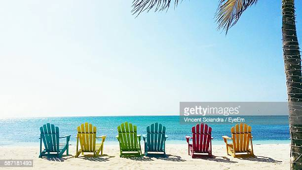 Multi Colored Deck Chairs At Beach