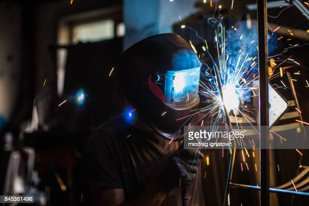 multi colored details of sparks from a welding torch - in flames i the mask stock pictures, royalty-free photos & images