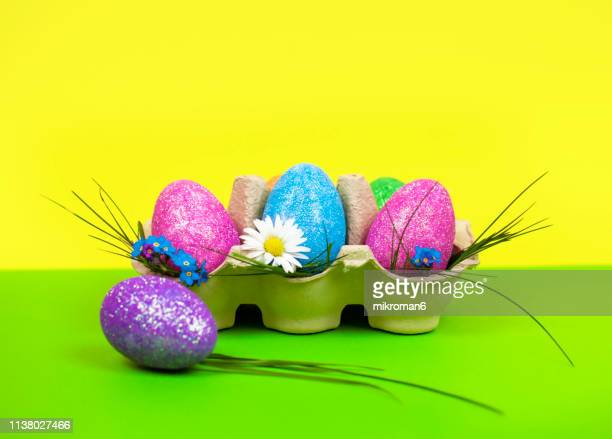 multi colored easter eggs against white background. - ツートンカラー ストックフォトと画像
