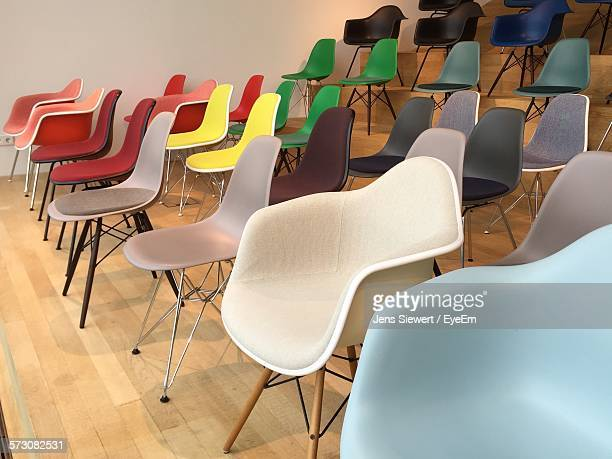 Multi Colored Empty Chairs Arranged In Room