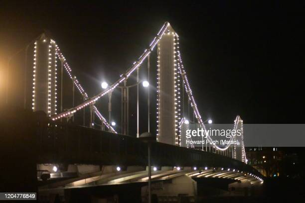 multi colored festival of light & architecture - chelsea bridge - howard pugh stock pictures, royalty-free photos & images