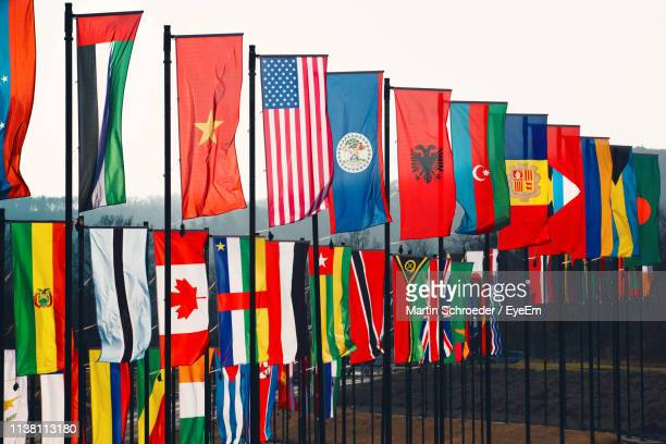 multi colored flags against clear sky - martin stange stock-fotos und bilder