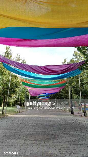 multi colored from fabric of several colours against sky - millennial pink stock pictures, royalty-free photos & images