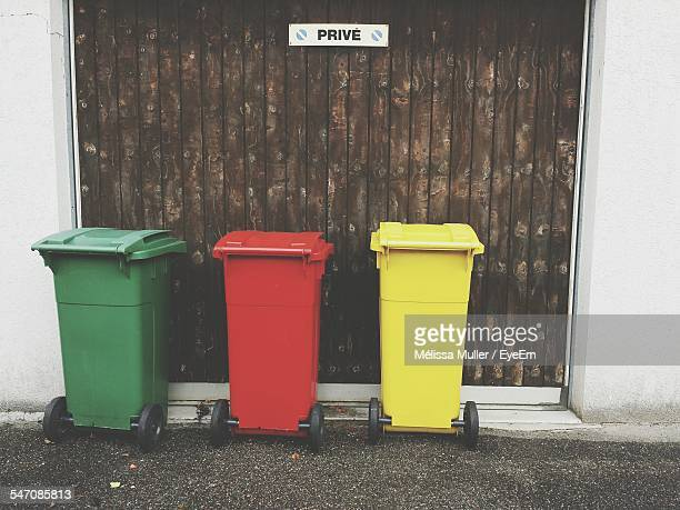 Multi Colored Garbage Bins Outside House