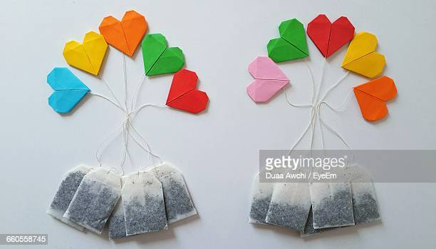 Multi Colored Heart Shapes Made From Teabags On Table