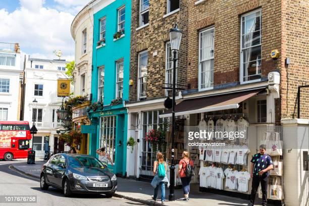 Multi colored houses and boutique shops on Portobello Road, London, UK