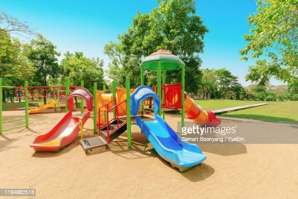 multi colored jungle gym at playground against trees - leisure equipment stock pictures, royalty-free photos & images