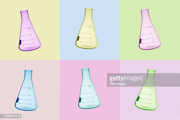 multi colored laboratory flasks - beaker stock pictures, royalty-free photos & images