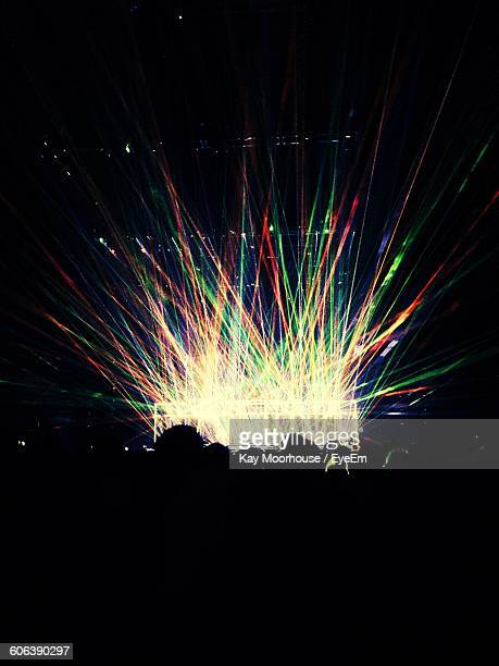 Multi Colored Light Beams At Music Concert