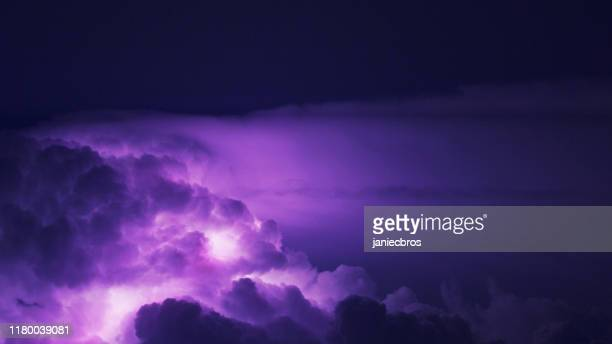 multi colored lightning. - purple sky stock pictures, royalty-free photos & images