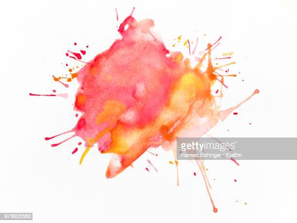 multi colored liquid splashing over white background - splattered stock pictures, royalty-free photos & images