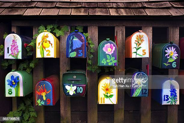 Multi Colored Mail Boxes With Floral Patterns