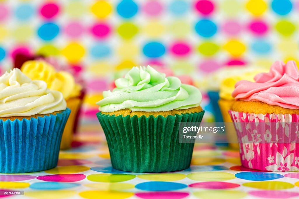 Multi colored muffins : Stock Photo