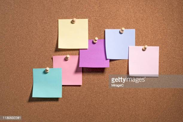 multi colored note paper on cork board - bulletin board stock pictures, royalty-free photos & images
