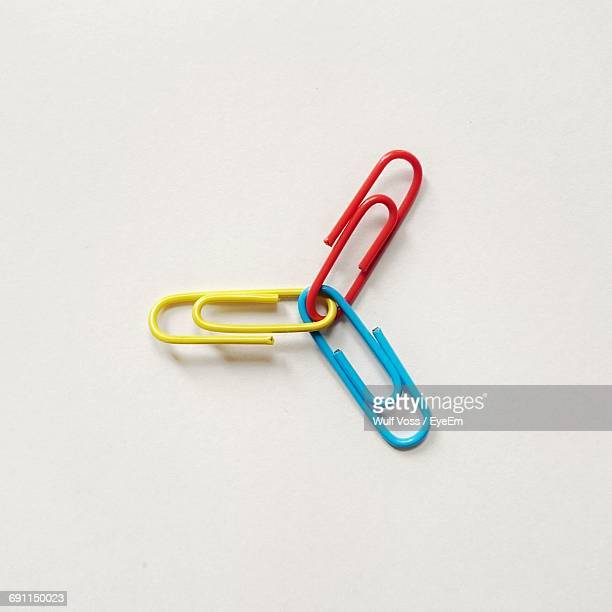multi colored paper clips - paper clips stock photos and pictures