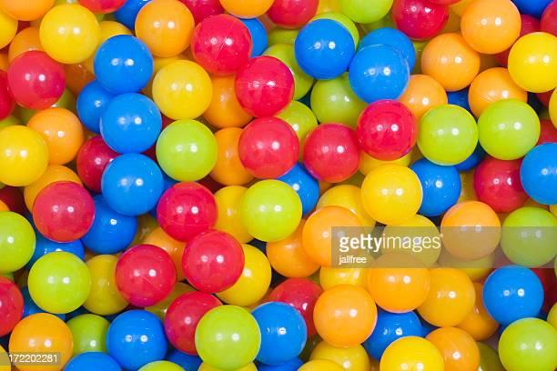 Multi colored red, blue, yellow, green plastic balls