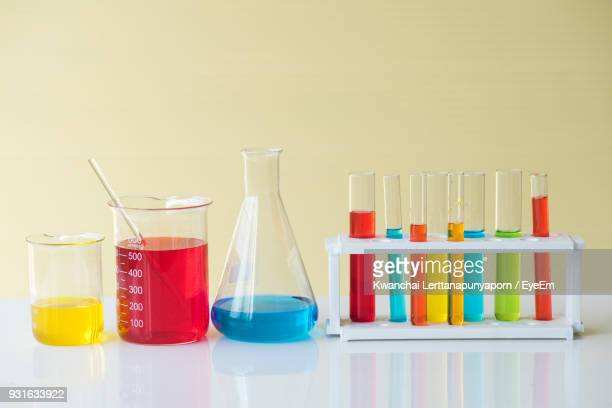 multi colored scientific equipment on table - laboratory equipment stock photos and pictures