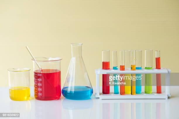 multi colored scientific equipment on table - フラスコ ストックフォトと画像