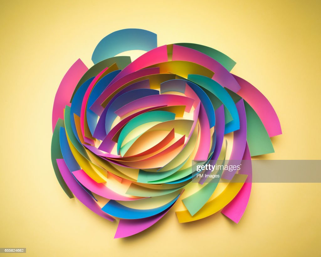 Multi Colored Sheets Of Paper In Circular Pattern Stock Photo ...