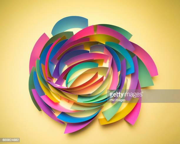 Multi colored sheets of paper in circular pattern