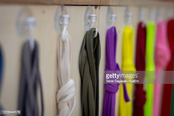 multi colored shoe laces hanging on the stand - purple shoe stock pictures, royalty-free photos & images