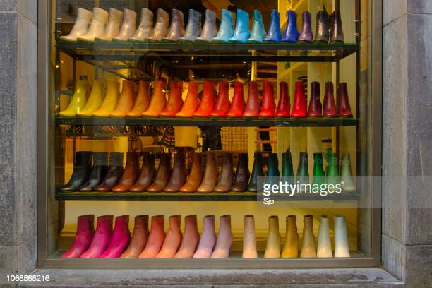 Multi colored shoes in a shop window