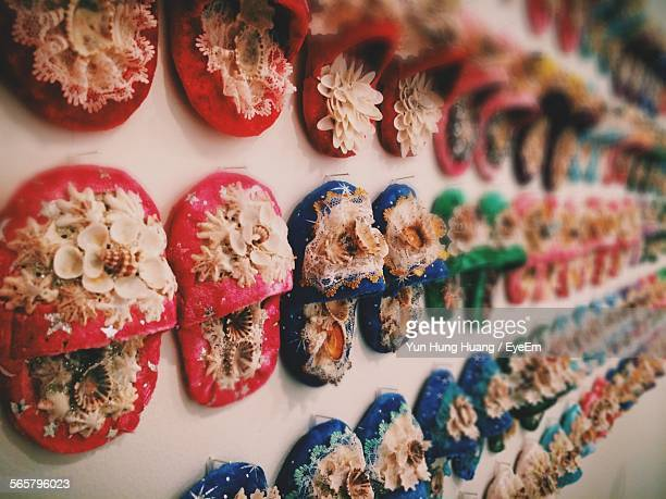multi colored slippers hanging on wall for sale - eyeem collection stock photos and pictures