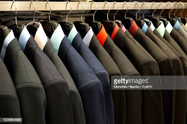 multi colored suits hanging at market for sale - multi colored suit stock pictures, royalty-free photos & images
