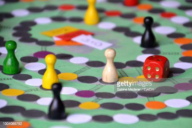 multi colored tokens and dice on table - board game stock pictures, royalty-free photos & images